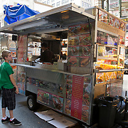 Eating from a street vendor in New York city.