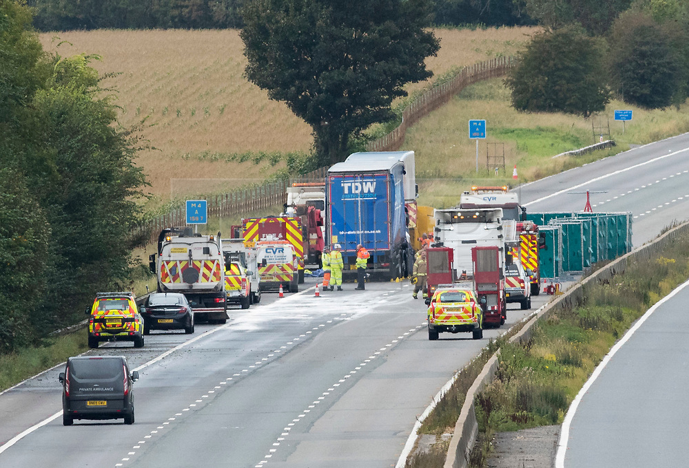 © Licensed to London News Pictures; 24/09/2020; M4, near Grittleton, Wiltshire, UK. A private ambulance arrives on the scene as emergency Services attend a second fatal accident on the M4, this time on the westbound carriageway involving two lorries, a car and a van. Two people died in the two separate crashes on the M4 overnight. The first happened at about 01:35 BST when a car overturned between Bath and Chippenham, killing one man and leaving another with life-threatening injuries. Two lorries, a car and a van then crashed in the same area between junctions 17 and 18. One man died and two others were injured. Emergency services say two serious accidents on the M4 have caused the motorway to be shut and it may remain shut all morning, and have been long delays on diversion routes. A third accident has been reported westbound before junction 17. Photo credit: Simon Chapman/LNP.