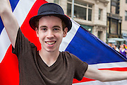 A young man from Equality is Great Britain and Northern Ireland spreads a Union Jack behind him.