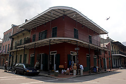 """03 Sept  2005. New Orleans, Louisiana. Post hurricane Katrina.<br /> Johnny White's Sports Bar on Bourbon Street in the French Quarter - with it's claim to """"Never Close."""" The bar has remained open throughout.  <br /> Photo Credit ©: Charlie Varley/varleypix.com"""