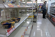 Empty shelves in convenience stores as people stock up on food after a magnitude 9 earthquake and large tsunami hit the Tohoku region of north east Japan  on March 11th killing nearly 20,000 people and causing massive destruction along the whole coast, and a melt-down at the Fukushima Daichi nuclear power station. Shinjuku, Tokyo, Japan March 16th 2011