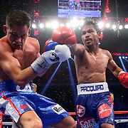MACAU - NOVEMBER 23:  Manny Pacquiao of the Philippines punches Chris Algieri of the United States during the WBO world welterweight title at The Venetian on November 23, 2014 in Macau, Macau.  (Photo by Chris Hyde/Getty Images) *** Local Caption *** Manny Pacquiao; Chris Algieri