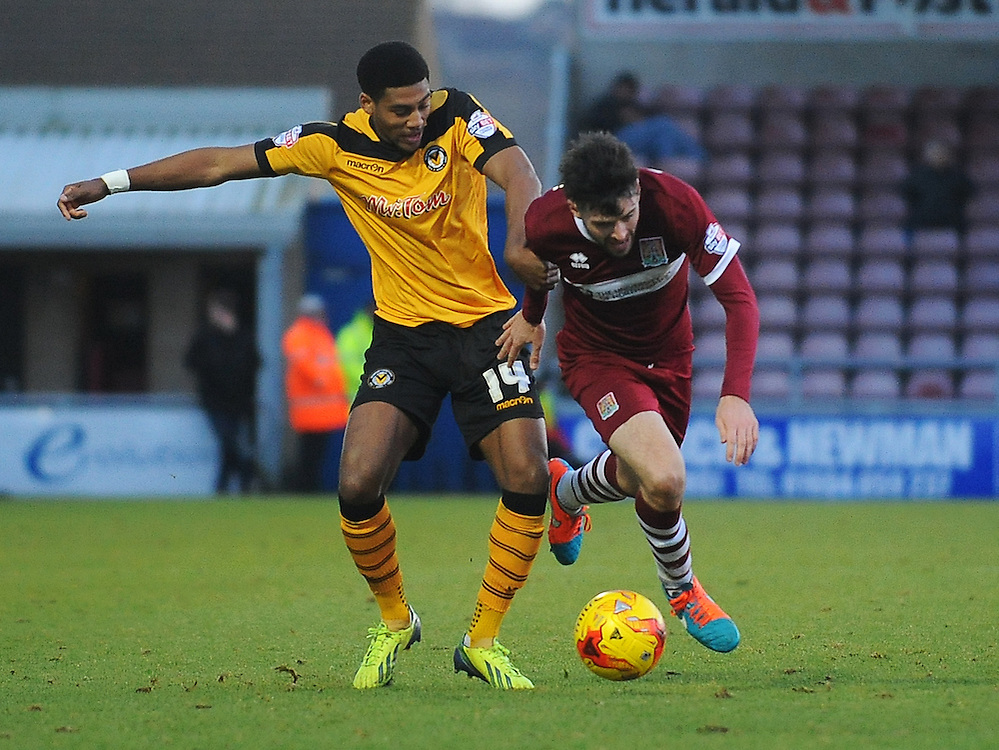 Northampton Town's Brendon Moloney under pressure from Newport County's Sean Jeffers<br /> <br /> Photographer Kevin Barnes/CameraSport<br /> <br /> Football - The Football League Sky Bet League Two - Northampton Town v Newport County AFC - Saturday 24rd January 2015 - Sixfields Stadium - Northampton<br /> <br /> © CameraSport - 43 Linden Ave. Countesthorpe. Leicester. England. LE8 5PG - Tel: +44 (0) 116 277 4147 - admin@camerasport.com - www.camerasport.com