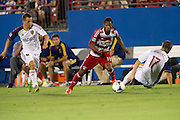 FRISCO, TX - JULY 13:  Fabian Castillo #11 of FC Dallas beats two Real Salt Lake defenders on July 13, 2013 at FC Dallas Stadium in Frisco, Texas.  (Photo by Cooper Neill/Getty Images) *** Local Caption *** Fabian Castillo