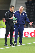 Cardiff City manager Neil Warnock gestures to Fourth Official Tony Harrington during the EFL Sky Bet Championship match between Derby County and Cardiff City at the Pride Park, Derby, England on 13 September 2019.