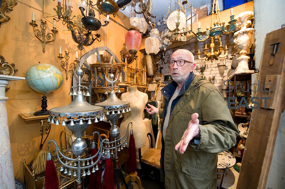 PARIS, FRANCE - APRIL 25: Antique dealer Claude Zenatti poses in his store, the smallest (5 square meters) of Paul Bert market, part of Saint-Ouen flea market, on April 25, 2014, outside Paris, France. Gerald Cavendish Grosvenor, the sixth Duke of Westminster and Britain's eighth richest man, has just bailed out of a nine-year battle against French dealers from two of the most prestigious antiques sections of the 130-year-old Paris flea market, or 'Marché aux puces de Saint Ouen' – the world's largest, with five million visitors a year. In 2005, the Duke paid €50 million (£41 million) for its high-end Serpette and Paul-Bert sections; last week he sold the lot at a reported €20 million loss to French landowner Jean-Cyrille Boutmy. (Photo by Lucas Schifres/Getty Images)