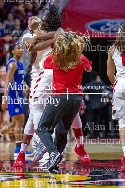 NORMAL, IL - December 20: Te Te Maggett gets a congratulation hug from Simone Goods after hitting a half court buzzer beater to end the first half of play during a college women's basketball game between the ISU Redbirds and the St. Louis Billikens on December 20 2018 at Redbird Arena in Normal, IL. (Photo by Alan Look)