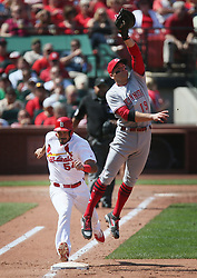 September 14, 2017 - St Louis, MO, USA - Cincinnati Reds first baseman Joey Votto, right, is drawn off the bag by a high throw by shortstop Zack Cozart as the St. Louis Cardinals' Alex Mejia reaches safely on the error in the fourth inning on Thursday, Sept. 14, 2017, at Busch Stadium in St. Louis. The Cards won, 5-2. (Credit Image: © Chris Lee/TNS via ZUMA Wire)