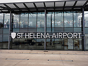 """Saint Helena Airport.<br /> <br /> they have one flight x week form South Africa and it is the only way to get in and out of the island.<br /> <br /> Since discovery in 1502, until the start of commercial flights in October 2017, the sea route had been the only way to reach St Helena. At its peak more than 1,000 ships a year visited on the way to and from India and the Far East via the Cape of Good Hope. That declined after 1869 with the opening of the Suez Canal.<br /> <br /> The age of the airplane bypassed St. Helena because it offered no flat land for a runway and was consistently buffeted by treacherous winds sweeping off the water. But in the hope of stoking the tourist trade, the British spent almost $400 million to fill in a valley by 2014 with some 800 million pounds of dirt and rock to solve the runway problem and build an airport. Today, only a special, stripped-down Embraer 190 jet with the best pilots in the world can stick the landing. The airport was, soon after, dubbed as the """"world's most useless airport"""" due to high winds and difficult landings."""