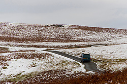 © Licensed to London News Pictures. 07/01/2021. Builth Wells, Powys, Wales, UK. A motorist drives along a small road on the Mynydd Epynt range in a freezing cold wintry landscape near Builth Wells in Powys, UK. After temperatures dropped to around minus 3 deg C. Photo credit: Graham M. Lawrence/LNP
