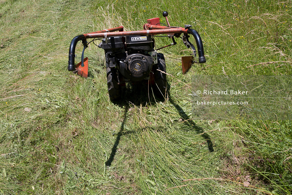 A powered agricultural grass mower, on 18th June 2018, in Kupljenik, Slovenia