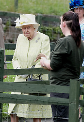The Queen visited Gorgie City Farm in Edinburgh today as part of Royal Week.<br /> <br /> Gorgie City Farm is a community based initiative first opened in 1982<br /> <br /> Pictured: The Queen is shown around the inner city farm and looks unsure about meeting Olive The Duck<br /> <br /> Alex Todd | Edinburgh Elite media