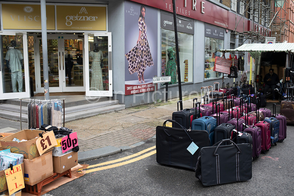 Luggage for sale on Pettycoat Lane Market in the City of London on 2nd February 2020 in London, England, United Kingdom. Petticoat Lane Market is a fashion and clothing market in the East End of London. It consists of two adjacent street markets. Wentworth Street Market is open six days a week, and Middlesex Street Market is open on Sunday only. The name Petticoat Lane came from not only the sale of petticoats but from the fable that they would steal your petticoat at one end of the market and sell it back to you at the other.