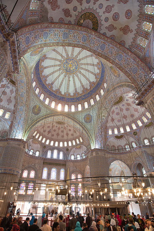 Tourists view domes of the Blue Mosque, Sultanahmet Camii or Sultan Ahmed Mosque 17th Century in Istanbul, Turkey