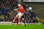 Cauley Woodrow of Barnsley (9) heads the ball during the EFL Sky Bet League 1 match between Barnsley and Sunderland at Oakwell, Barnsley, England on 12 March 2019.