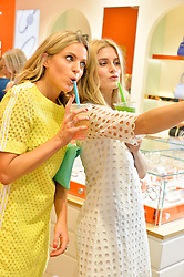 Left to right, OLIVIA COX and ASHLEY JAMES at a Hello! magazine and Folli Follie shopping evening at Folli Follie, 493 Oxford Street, London on 25th August 2016.