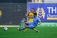 Coventry City midfielder Michael Doyle (8) tackles Oxford United midfielder Ricky Holmes (12) during the EFL Sky Bet League 1 match between Oxford United and Coventry City at the Kassam Stadium, Oxford, England on 9 September 2018.