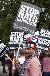 © Licensed to London News Pictures. 30/08/2014. Newport, Gwent, UK. Supporters of World Peace march against NATO war policies. 150 heads of state and ministers will attend a NATO summit at The Celtic Manor next week.  Worldwide Peace Supporters will arrive to take part in a week of peaceful protest and alternative Peace Summit. A 12 mile 'ring of steel' fence is in place at key sites and 9,500 police officers drawn from all 43 police forces in England and Wales. Photo credit: Graham M. Lawrence/LNP