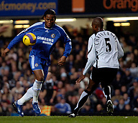 Photo: Ed Godden.<br />Chelsea v Fulham. The Barclays Premiership. 30/12/2006.<br />Chelsea's Didier Drogba (L), is met by Philippe Christanval.