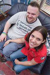 Young couple sitting on the sofa smiling,