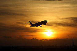 File photo dated 19/11/08 of a plane taking off from Heathrow Airport at sunset, as the Scottish Government backed the building of a third runway at Heathrow.