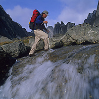 MOUNTAINEERING, Jim Zellers (MR) fords stream, Cirque of the Unclimbables, NWT, Canada