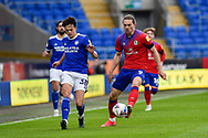 Sam Gallagher (9) of Blackburn Rovers battles for possession with Perry Ng (38) of Cardiff City during the EFL Sky Bet Championship match between Cardiff City and Blackburn Rovers at the Cardiff City Stadium, Cardiff, Wales on 10 April 2021.