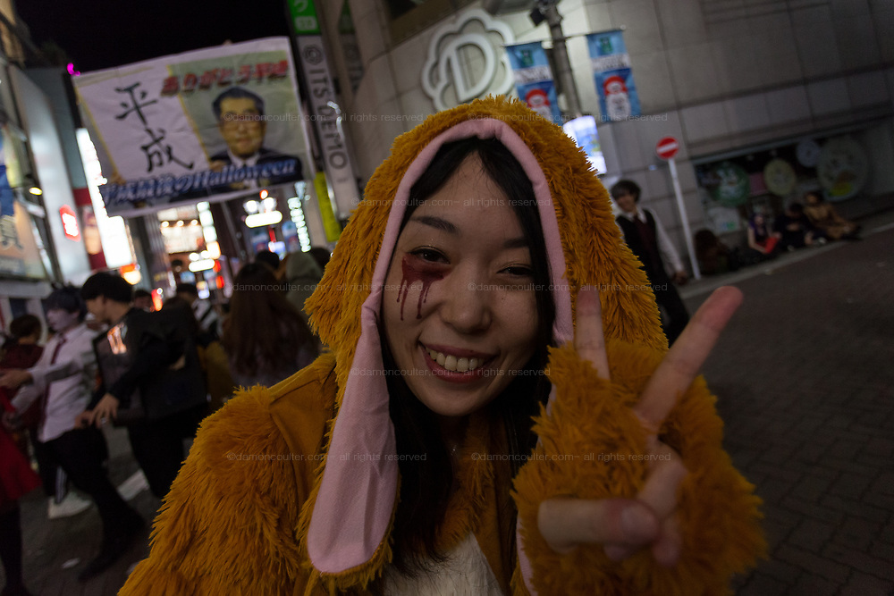 A Japanese woman dressed as a rabbit gives a peace sign during the Halloween celebrations Shibuya, Tokyo, Japan. Sunday morning October 28th 2018