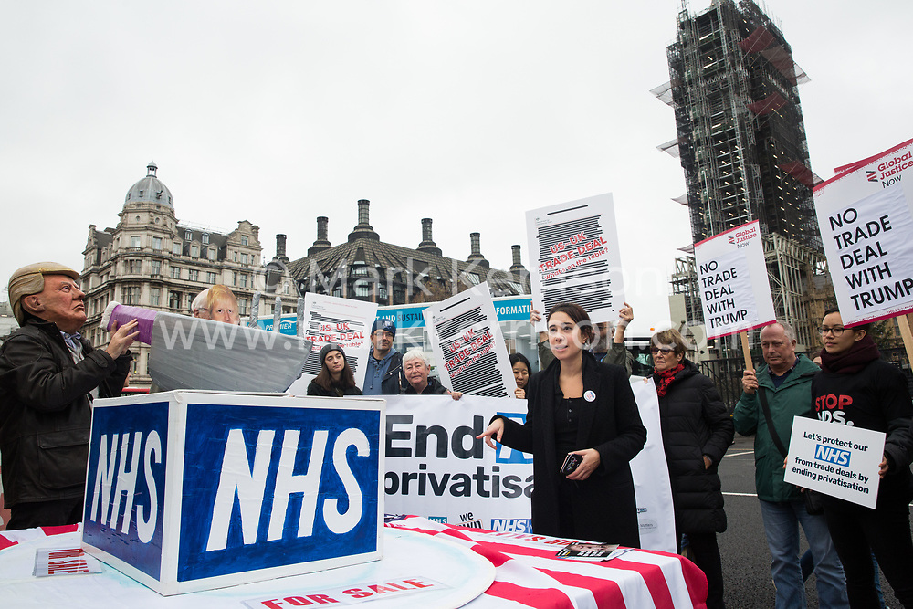 London, UK. 25 November, 2019. Dr Mona Kamal addresses campaigners from Keep Our NHS Public, Health Campaigns Together, We Own It and Global Justice Now at a protest in Parliament Square to call on Prime Minister Boris Johnson to end privatisation of healthcare in the National Health Service (NHS).