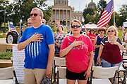 24 JULY 2021 - DES MOINES, IOWA: People say the Pledge of Allegiance during the World Wide Freedom Rally in Des Moines. More than 200 people showed up at the Iowa State Capitol Saturday for the World Wide Freedom Rally. The protesters called for governments everywhere to respect five important freedoms: Freedom of Speech, Movement, Choice, Assembly, and Health. Their main concern Saturday was Freedom of Health, which they said included the freedom to refuse vaccinations and the freedom to refuse to wear face masks, even during the time of airborne viruses.       PHOTO BY JACK KURTZ