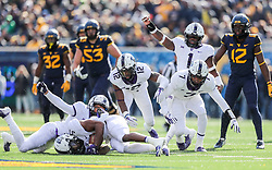 Nov 10, 2018; Morgantown, WV, USA; TCU Horned Frogs defensive players celebrate after TCU Horned Frogs safety Ridwan Issahaku (31) intercepts a pass during the second quarter against the West Virginia Mountaineers at Mountaineer Field at Milan Puskar Stadium. Mandatory Credit: Ben Queen-USA TODAY Sports
