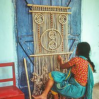 A women weaves macrame to sell in Dhaka, Bangladesh.