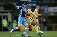 Photo: Marc Atkins.<br />Wycombe Wanderers v Oxford United. The FA Cup. 11/11/2006. Matt Bloomfield of Wycombe and Yemi Odubade of Oxford in action.