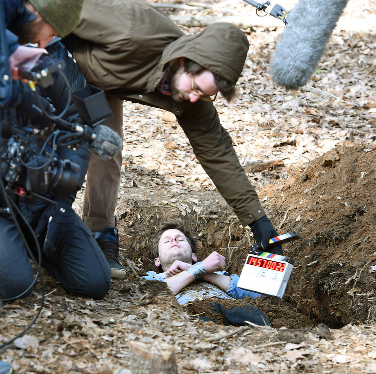 """April 5, 2016, Guilford, CT<br /> Mara Lavitt -- Special to the Hartford Courant<br /> Guilford native Matt Newton of Greenwich on his family's property in Guilford making his horror short-film """"Hide/Seek."""" Director of photography Kristian Borysevicz of NYC gets ready to shoot a scene with actor Bryan Manley Davis of Brooklyn, NY in a shallow grave. First assistant camera and Guilford native Shane Rubano of NYC holds the slate."""
