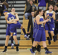 Wallkill players celebrate their victory over Onteora in the Mid-Hudson Athletic League girls' basketball championship game at Ulster County Community College in Stone Ridge on Thursday, Feb. 21, 2013.