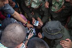 El Diamante, Meta, Colombia - 17.09.2016        <br /> <br /> FARC fighter view pictures together during the the 10th conference of the marxist FARC-EP in El Diamante, a Guerilla controlled area in the Colombian district Meta. Few days ahead of the peace contract passing after 52 years of war with the Colombian Governement wants the FARC decide on the 7-days long conferce their transformation into a unarmed political organization. <br /> <br /> FARC Kaempfer betrachten Fotos waehrend der zehnten Konferenz der marxistischen FARC-EP in El Diamante, einem von der Guerilla kontrollierten Gebiet im kolumbianischen Region Meta. Wenige Tage vor der geplanten Verabschiedung eines Friedensvertrags nach 52 Jahren Krieg mit der kolumbianischen Regierung will die FARC auf ihrer sieben taegigen Konferenz die Umwandlung in eine unbewaffneten politischen Organisation beschlieflen. <br />  <br /> Photo: Bjoern Kietzmann
