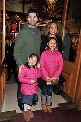 ANGELA GRIFFIN and her husband JASON MILLIGAN and their children MISSY & TALLULAH at Cirque du Soleil's VIP night of Kooza held at the Royal Albert Hall, London on 8th January 2013.