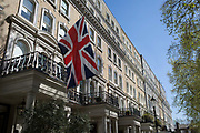 The union Jack flies from a property balcony in Beaufort Gardens, on 9th April 2017 in Knightsbridge, London SW3, England.