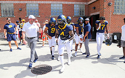 Sep 4, 2021; College Park, Maryland, USA; West Virginia Mountaineers running back Leddie Brown (4) leads his team out during warmups prior to their game against the Maryland Terrapins at Capital One Field at Maryland Stadium. Mandatory Credit: Ben Queen-USA TODAY Sports