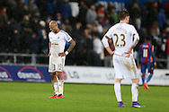 Gylfi Sigurdsson (23) and Andre Ayew of Swansea city look on dejected at the final whistle after their team can only manage a 1-1 draw. Barclays Premier league match, Swansea city v Crystal Palace at the Liberty Stadium in Swansea, South Wales on Saturday 6th February 2016.<br /> pic by Andrew Orchard, Andrew Orchard sports photography.