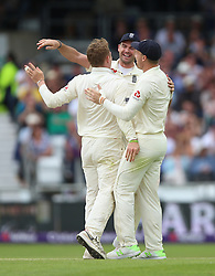 England's Dom Bess (left) celebrates after taking the wicket of Pakistan's Imam ul-Haq with James Anderson (centre) and Jos Buttler (right) during day three of the Second NatWest Test match at Headingley, Leeds.