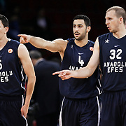 Anadolu Efes's Vlado ILIEVSKI (L), Dogus BALBAY (C) and Sinan GULER (R) during their Two Nations Cup basketball match Anadolu Efes between Panathinaikos at Abdi Ipekci Arena in Istanbul Turkey on Saturday 01 October 2011. Photo by TURKPIX
