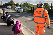 Environmental activists from HS2 Rebellion sit in the road holding banners to block a gate providing access to a site for the HS2 high-speed rail link on 12 September 2020 in Harefield, United Kingdom. Anti-HS2 activists continue to try to prevent or delay works on the controversial £106bn HS2 high-speed rail link in the Colne Valley where thousands of trees have already been felled.