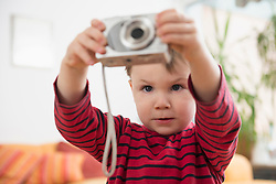Boy taking pictures with camera