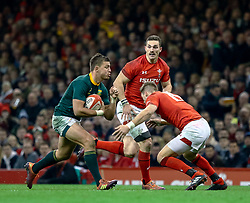 Handre Pollard of South Africa under pressure from Liam Williams of Wales<br /> <br /> Photographer Simon King/Replay Images<br /> <br /> Under Armour Series - Wales v South Africa - Saturday 24th November 2018 - Principality Stadium - Cardiff<br /> <br /> World Copyright © Replay Images . All rights reserved. info@replayimages.co.uk - http://replayimages.co.uk