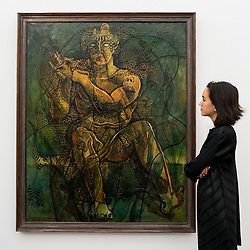 """© Licensed to London News Pictures. 01/11/2016. London, UK. A staff member views """"Mendica"""" by Francis Picabia, est. GBP600-800k. The first look of """"Bowie / Collector"""", artworks from the late David Bowie's personal art collection, ahead of their sale later this month at Sotheby's. Photo credit : Stephen Chung/LNP"""