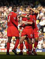 Photo. Jed Wee<br />Liverpool v Leeds United, FA Barclaycard Premiership, Anfield, Liverpool. 23/03/2003.<br />Liverpool's El Hadji Diouf (R) gives goalscorer Danny Murphy (C) a pat on the head as Emile Heskey looks on.