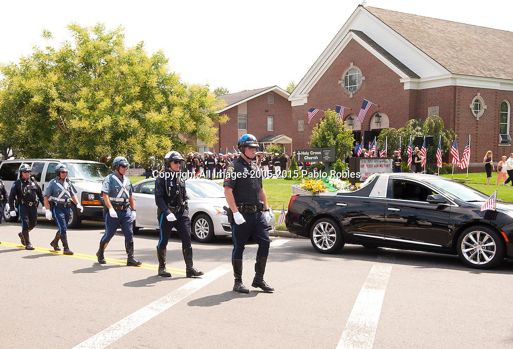 Supporters gather outside the Holy Cross Church during the funeral service for Marine Gunnery Sgt. Thomas Sullivan in Springfield, Mass., Monday, July 27, 2015. Sullivan is one of the five service men killed in the July 16 shooting in Chattanooga, TN.