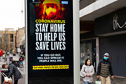 Glasgow, Scotland, UK. 1 April, 2020. Effects of Coronavirus lockdown on Glasgow life, Scotland. Video screen showing coronavirus warning message on Sauchiehall Street.