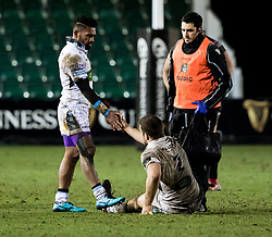 Glasgow Warriors' Nikola Matawalu helps up team-mate dejected James Malcolm after the match<br /> <br /> Photographer Simon King/Replay Images<br /> <br /> Guinness PRO14 Round 14 - Dragons v Glasgow Warriors - Friday 9th February 2018 - Rodney Parade - Newport<br /> <br /> World Copyright © Replay Images . All rights reserved. info@replayimages.co.uk - http://replayimages.co.uk